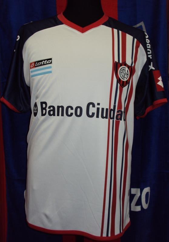 Cuervo Mania (Merchandising):        Camiseta Alternativa Blanca Lotto 2014 Banco Ciudad